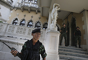 Thai soldiers stand guard outside Government House compound of prime minister's office