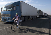 Trucks parked on a blocked road heading toward Crimea