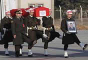 Turkish soldiers carry the national flag-draped coffin of the serviceman accidentally killed in a Russian airstrike around the northern Syrian town al Bab