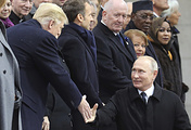 Russian President Vladimir Putin shakes hands with US President Donald Trump as he arrives to attend a ceremony at the Arc de Triomphe in Paris