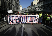 Demonstrators wearing yellow vests hold a banner during a march in Marseille