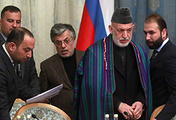 Afghanistan's former vice president Yunus Qanuni and Afghanistan's former president Hamid Karzai are seen during an intra-Afghan meeting in Moscow