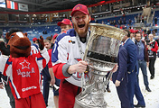 A CSKA Moscow player holds the Gagarin Cup trophy during the medal ceremony