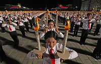 Youths stage a torchlight parade in Pyongyang's Kim Il-sung Square to celebrate the 70th anniversary of North Korea, September 10