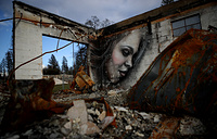 A mural by artist Shane Grammer is seen on the wall of a building destroyed by the Camp Fire in Paradise, California