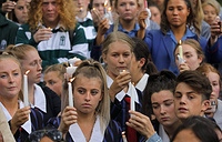 Students raise candles as they gather for a vigil to commemorate victims of the shooting outside the Al Noor mosque in Christchurch, New Zealand