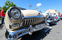 GAZ-21 Volga car is seen during the vintage car rally in Teatralny Proyezd Street