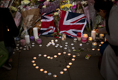A British flag is seen next to flowers after a vigil in Albert Square, Manchester after the suicide attack at an Ariana Grande concert that left 22 people dead