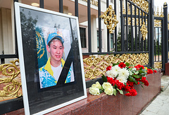 A portrait and flowers seen outside the Kazakh Embassy in Moscow in memory of Kazakhstan's figure skater Denis Ten
