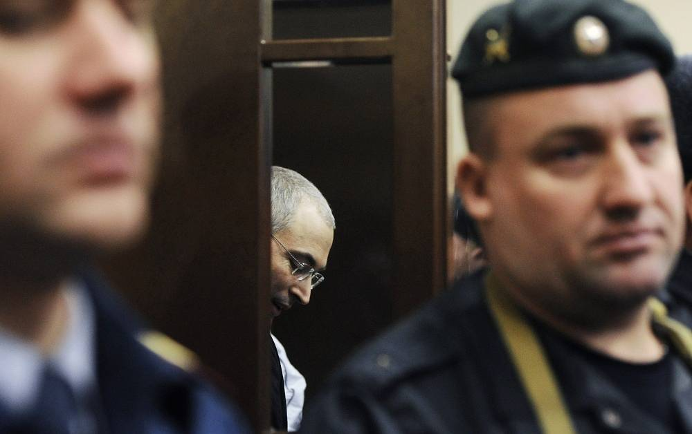 December 30, 2010. Mikhail Khodorkovsky (C), accused of embezzlement and legalization of third party's property during the sentencing in Khamovniki Court