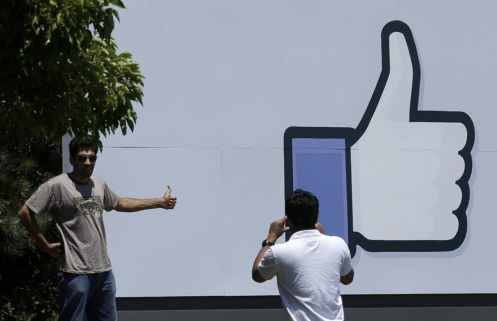 """An image of the """"Like"""" button at the entrance to the Facebook campus in Menlo Park, California"""