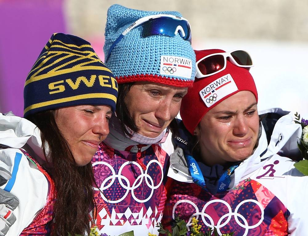 Charlotte Kalla, Marit Bjorgen and Heidi Weng after finishing the cross-country ski race