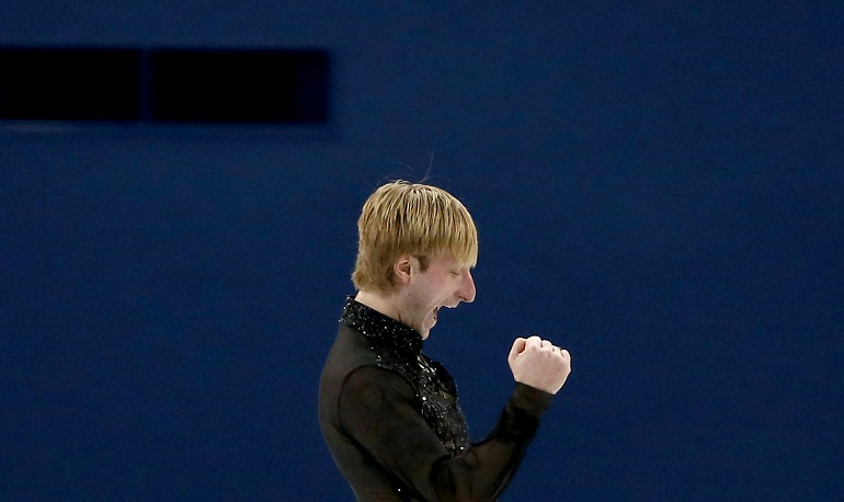 Yevgeny Plushenko won in men's free skating program