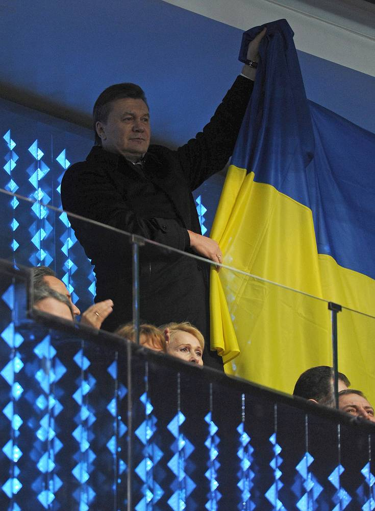 Ukraine's president Viktor Yanukovych waving his national flag during the opening ceremony of the Sochi 2014