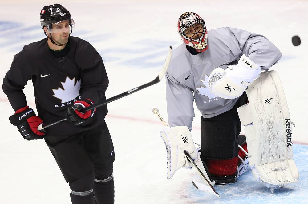 Canada's Jamie Benn and goalie Carey Price during training session