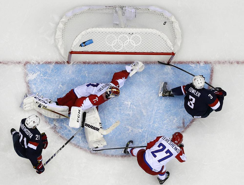 Cam Fowler (R) of the USA scores the 1-1 goal in the second period