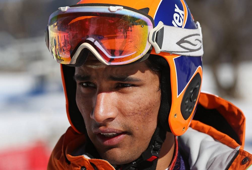 India's olympic commitee was disqualified by the IOC in 2012 and wasn't allowed to represent the national flag, but on Feb. 11 2014 the ban was lifted. Photo: India's Himanshu Thakur poses for a photo near the finish area for the alpine skiing at the Sochi 2014 Winter Olympics