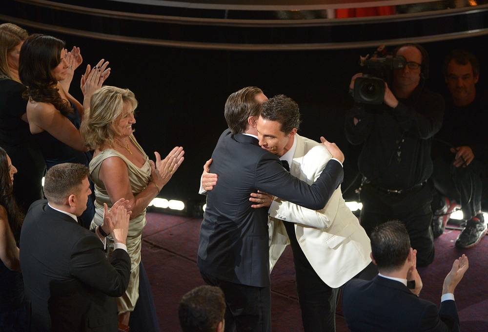 Leonardo DiCaprio, left, congratulates Matthew McConaughey for winning the award for best actor in a leading role