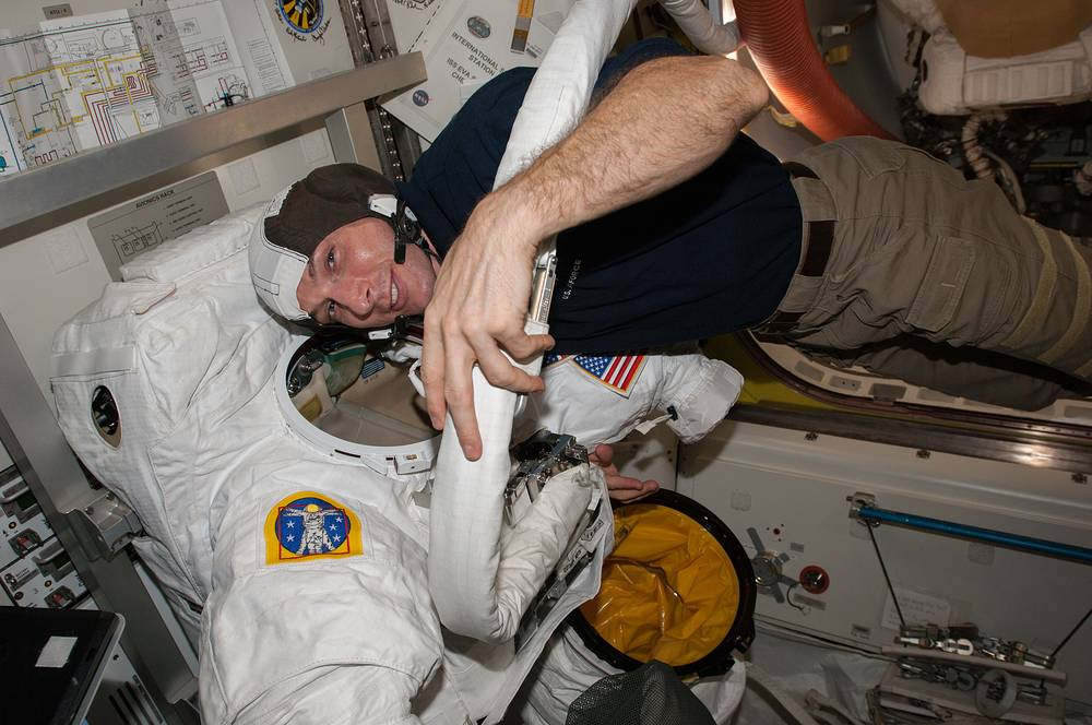 Mike Hopkins checking out a spacesuit before a spacewalk to replace an ammonia pump that is part of the station's coolant system, Dec. 21 2013