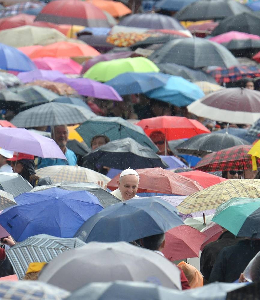 Despite heavy rainfall Pope Francis gives a cheery smile to devoted pilgrims on St. Peter's Square in Vatican