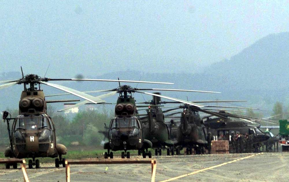 NATO Puma helicopters stand on the tarmac of Rinas military airport, near Tirana, Albania
