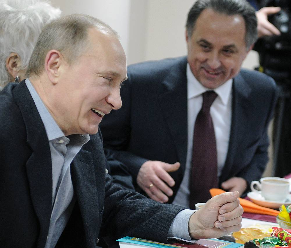 Vladimir Putin and Russian Sports Minister Vitaly Mutko