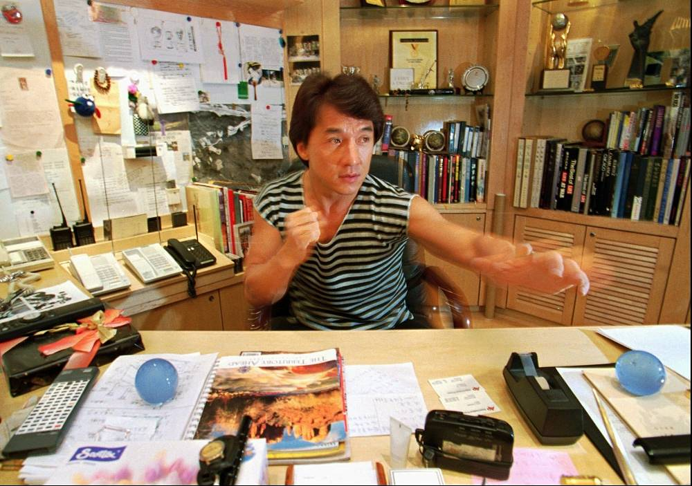 At first, Jackie Chan was a stunt man, then he started getting more important roles. Photo: Jackie Chan in his office in Hong Kong, 1995