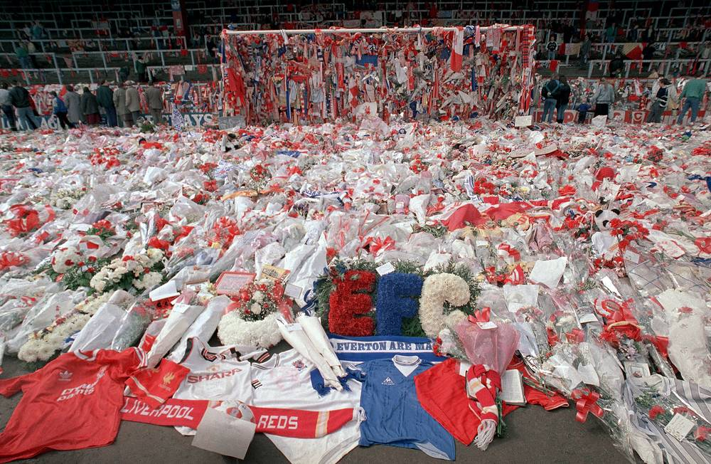 The police opened an exit gate which led to an already overcrowded sector of the stadium. This resulted in a stampede which killed 96 and injured 766 people.  Photo: flowers at Anfield Stadium on April 17, 1989