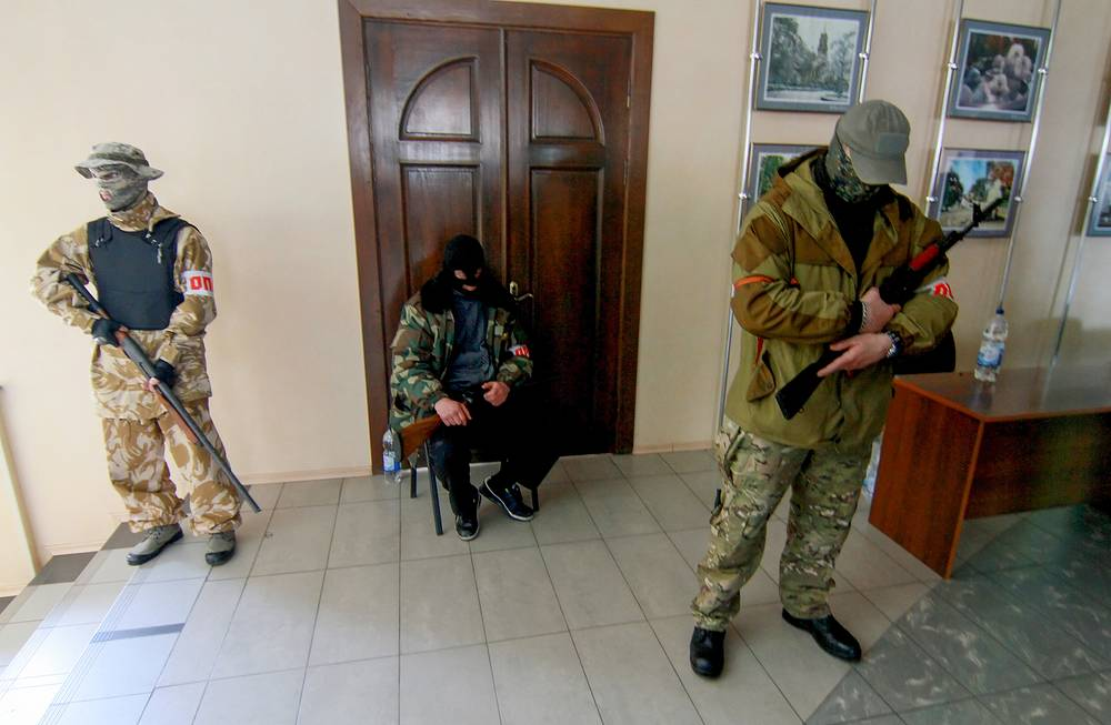 Protesters stand guard inside the seized city hall in Donetsk