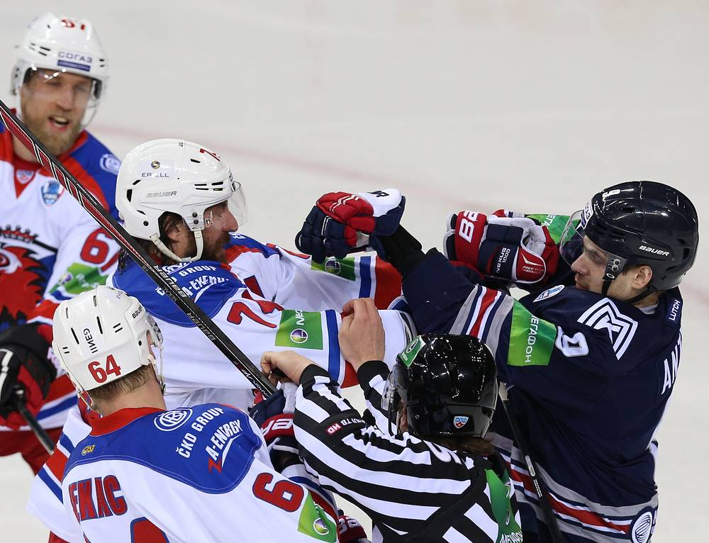 Lev Prague's Jiri Sekac (front), Martin Thornberg, Nathan Oystrick, and Metallurg's Viktor Antipin (L-R back) during a fight