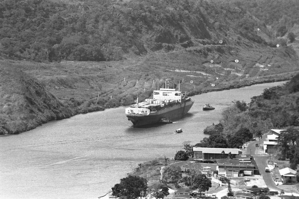 The Panama Canal connects the Atlantic Ocean to the Pacific Ocean. It's 77,1 km long
