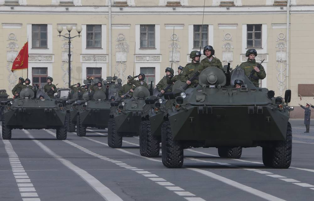 Military vehicles of Russian army drive across Dvortsovaya (Palace) Square in St. Petersburg
