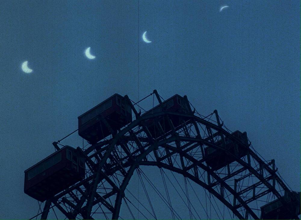 Multiple exposure of the four phases of a solar eclipse in Vienna, Austria in 1990
