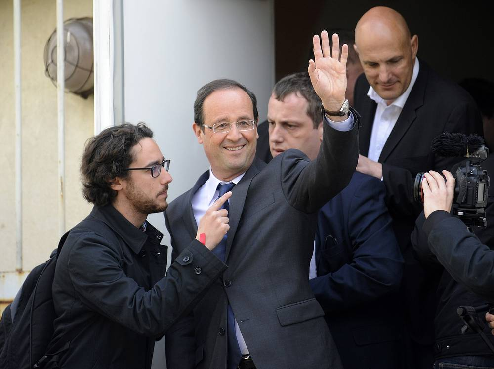 Francois Hollande (C) and his son Thomas Hollande (L)