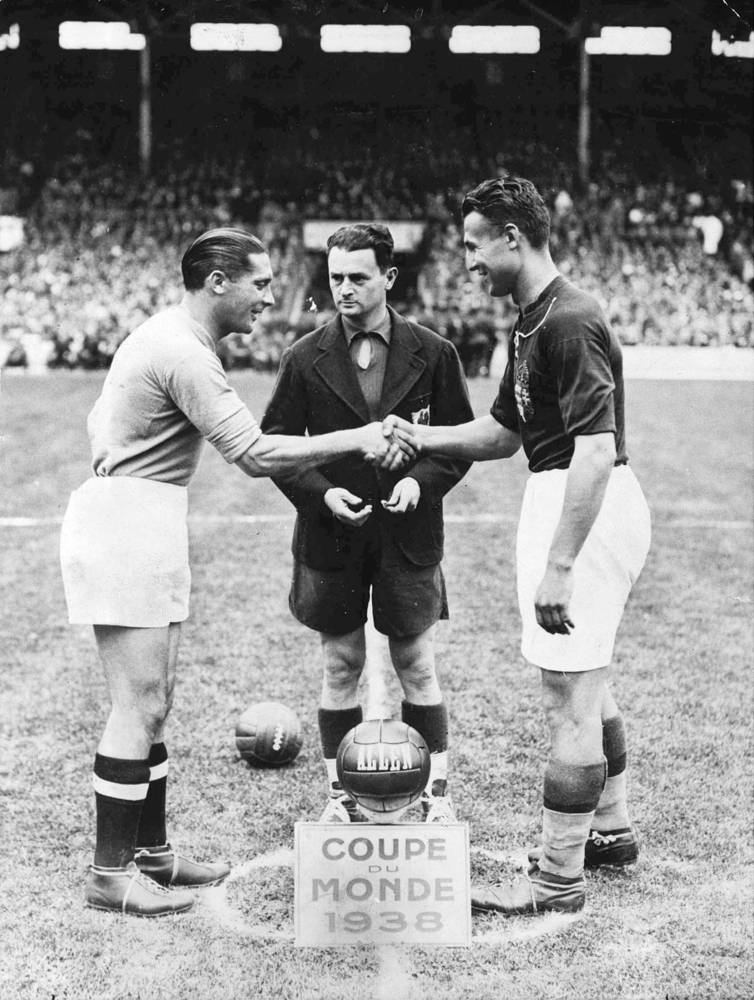 In 1938, Italy again made it to the final, this time with Hungary. The Italian team won by four goals to two. Photo: Italy's captain Giuseppe Meazza and Hungary's counterpart shake hands before the start of the World Cup Final