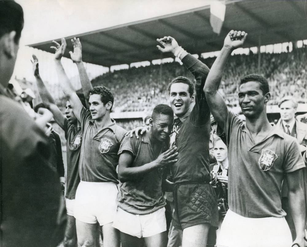 World Cup 1958 took place in Sweden. In the final the hosts lost to Brazil with the score of 5-2. Photo: Brazil's seventeen-year-old Pele (center) weeps on the shoulder of goalkeeper Gylmar Dos Santos Neves (right) after winning the final