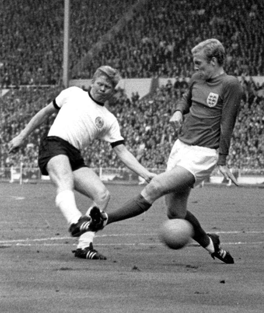 World Cup 1966 was held in England. In the Final, the host defeated West Germany by four goals to two. Photo: Germany's Helmut Haller in action with England's during the World Cup final at Wembley Stadium