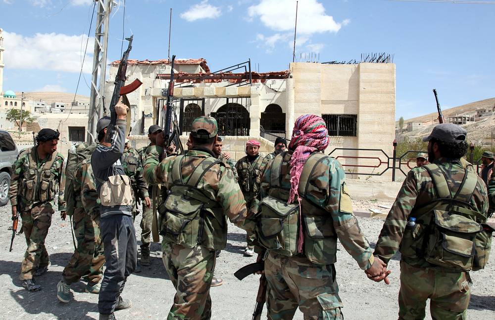 Syrian soldiers celebrate their victory on the outskirts og Damascus