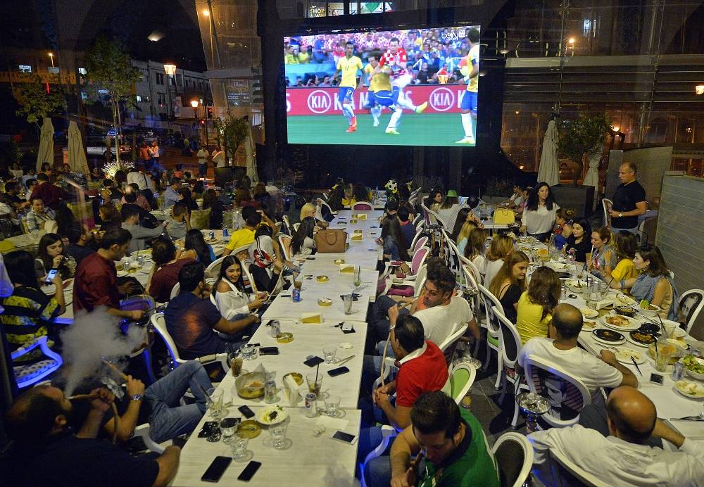 Supporters in Beirut, Lebanon, watch the opening match of the World Cup