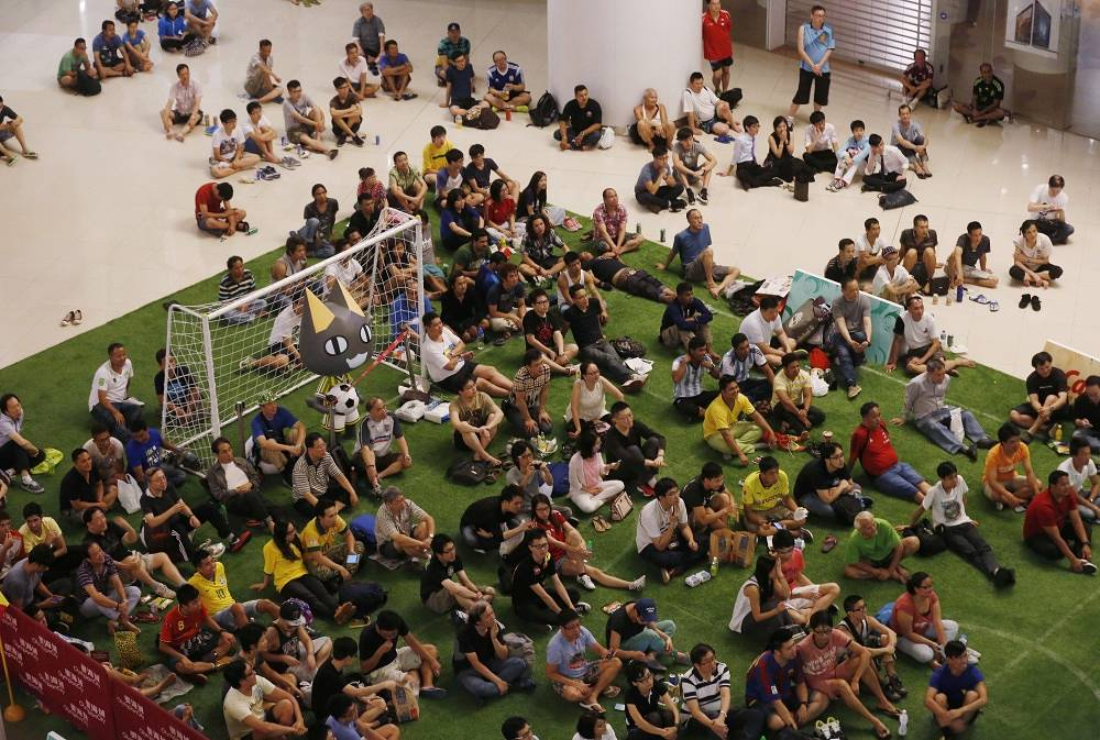Football supporters at a shopping mall in Hong Kong