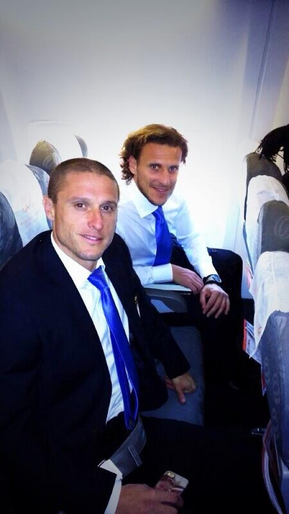 Argentina's Diego Forlan (right) and his team mate Diego Perez on board a plane