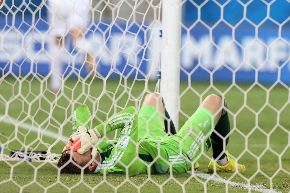 Goalkeeper Igor Akinfeev of Russia reacts following the 0-1 goal