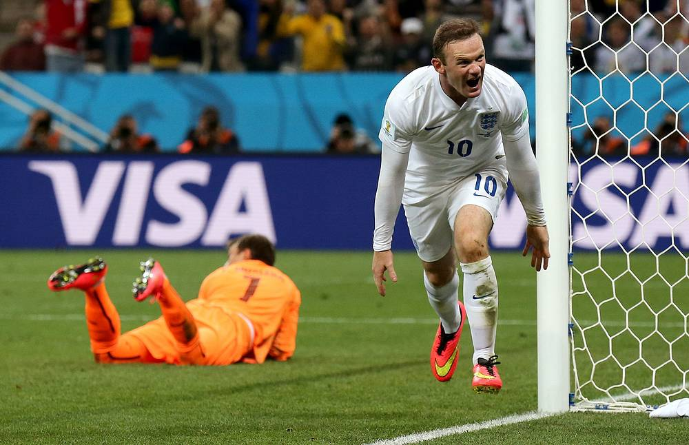 Wayne Rooney of England celebrates after scoring the 1-1 and thus breaking his 'World Cup curse', scoring his first goal in a world cup final stage match