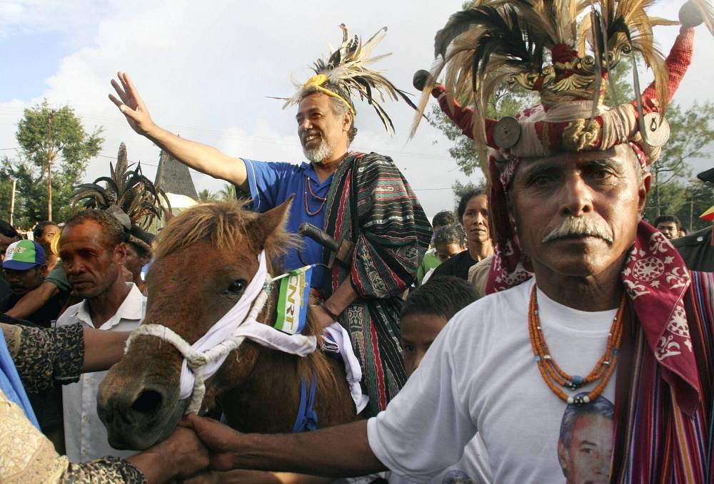 President of East Timor from 2002 to 2007  Xanana Gusmao (background) wearing traditional Timorese dress in 2007