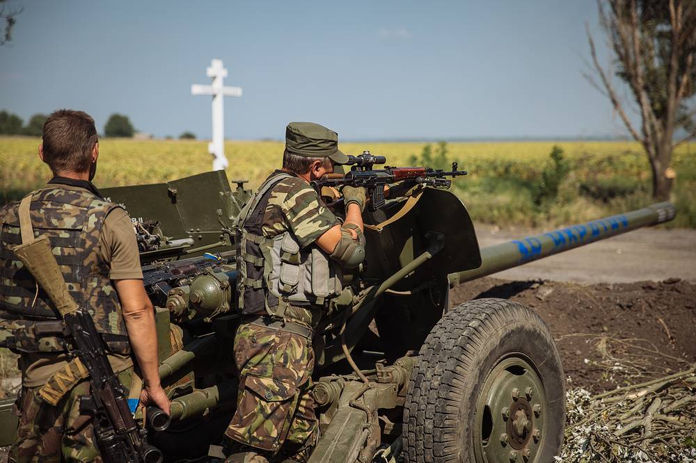 A Ukrainian sniper takes up a position during a battle against militia not far from Donetsk