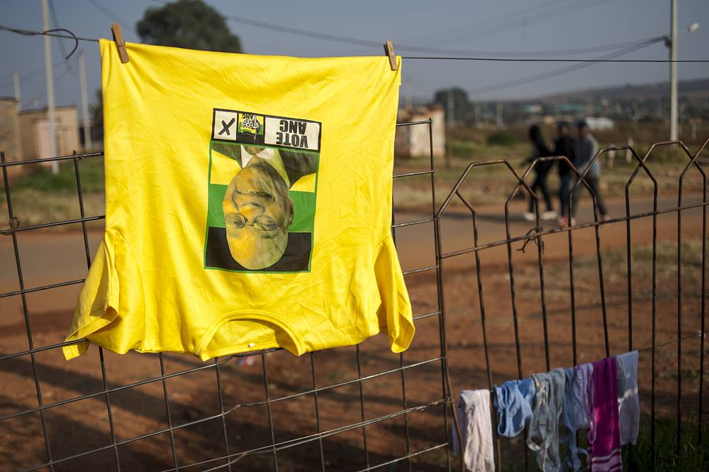 A t-shirt bearing the face of South African President Jacob Zuma hangs on a washing line
