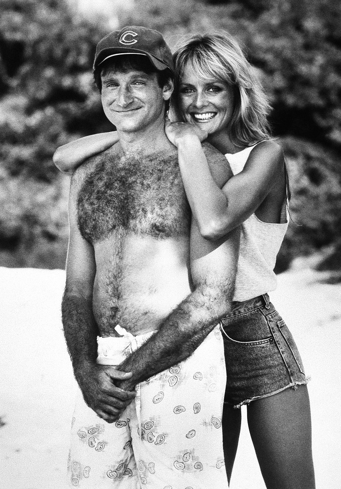 Robin Williams poses with actress and model Twiggy for the comedy 'Club Paradise', 1986