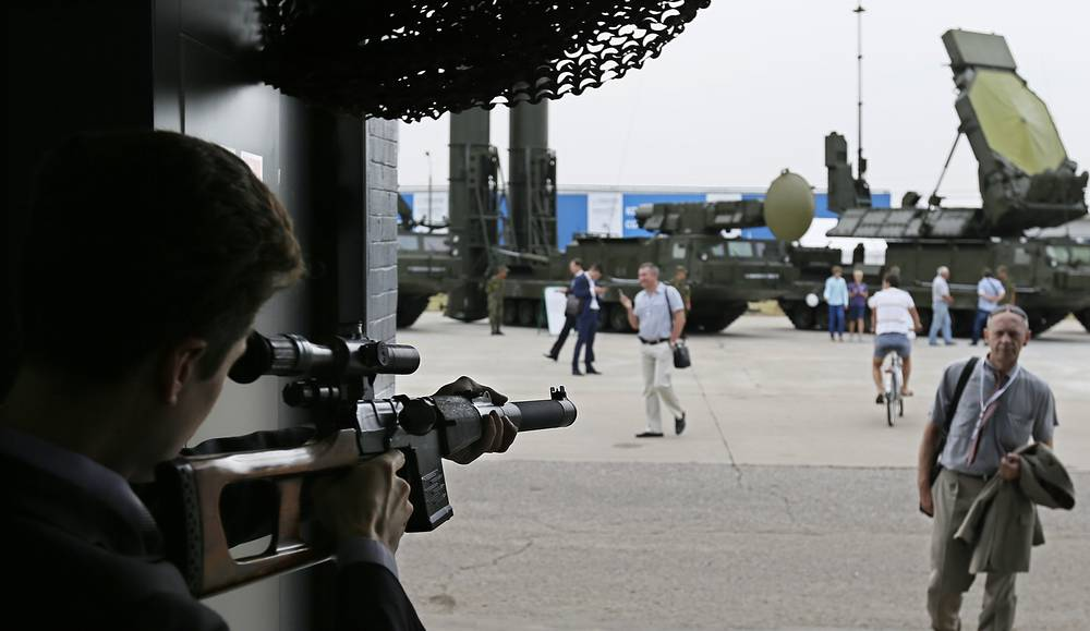 A man aims an automatic weapon