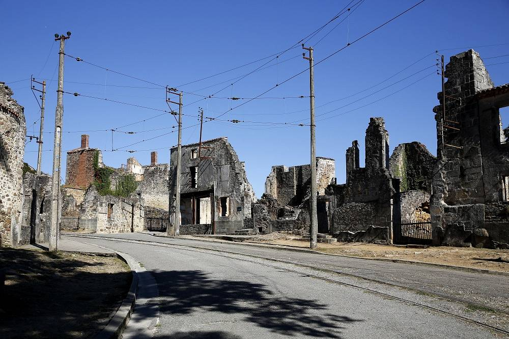 The French town of Oradour-sur-Glane was destroyed by German troops during the WWII. A new settlement was built nearby, and the old one is maintained as a memorial and museum