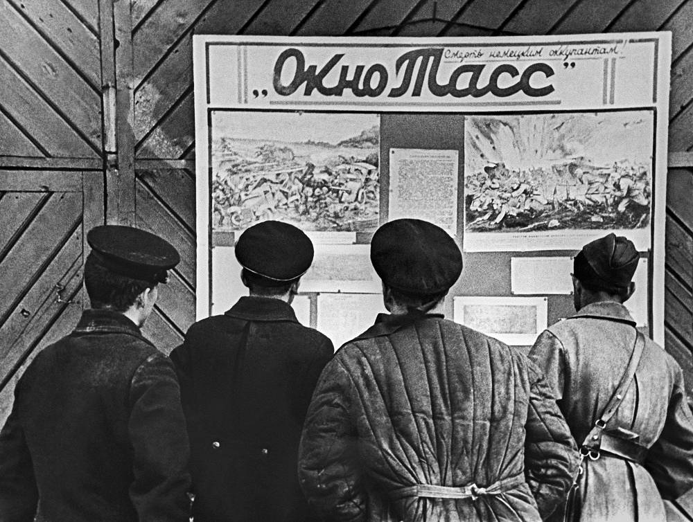 TASS windows posters displayed in a village on the western shore of Lake Ladoga during tha days of Leningrad blockade, 1941